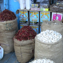 chili peppers and garlic at market