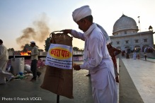 Khamu Ram Bishnoi installs the first dustbin near the temple dedicated to Bishnoi's prophet Jamboji, who edicted the 29 rules of the Bishnoi faith in the 15th century. The dustbin is modeled after the ones he saw in France to which he adds a sustainable twist: a jute bag.