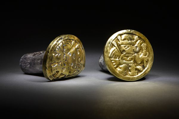 Photograph by Daniel Giannoni. Images of winged, supernatural beings adorn a pair of heavy gold-and-silver ear ornaments that a high-ranking Wari woman wore to her grave in the newly discovered mausoleum at El Castillo de Huarmey in Peru.