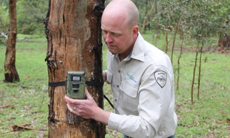 Park ranger Ryan Duffy checks a digital camera. Photograph: Parks Victoria