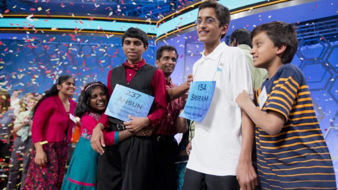 Ansun Sujoe, of Fort Worth, Texas, and Sriram Hathwar, of Painted Post, N.Y., were named co-champions of the 2014 Scripps National Spelling Bee on Thursday. Their siblings helped them celebrate the first shared title since 1962. Manuel Balce Ceneta/AP