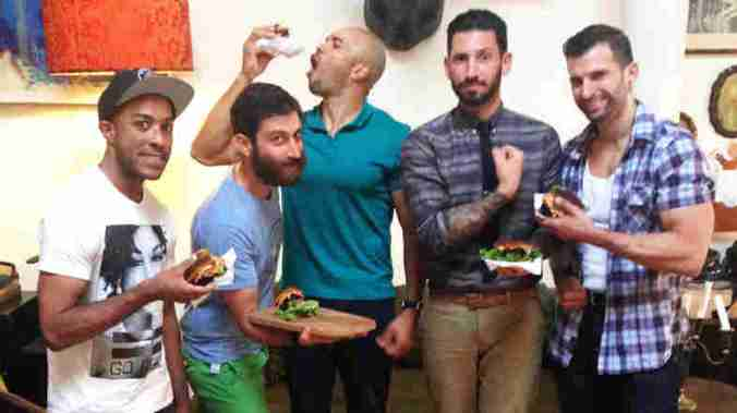 Mixed martial arts fighter Cornell Ward (from left), chef Daniel Strong, triathlete Dominic Thompson, lifestyle blogger Joshua Katcher and competitive bodybuilder Giacomo Marchese at a vegan barbecue in Brooklyn, N.Y. Courtesy of James Koroni