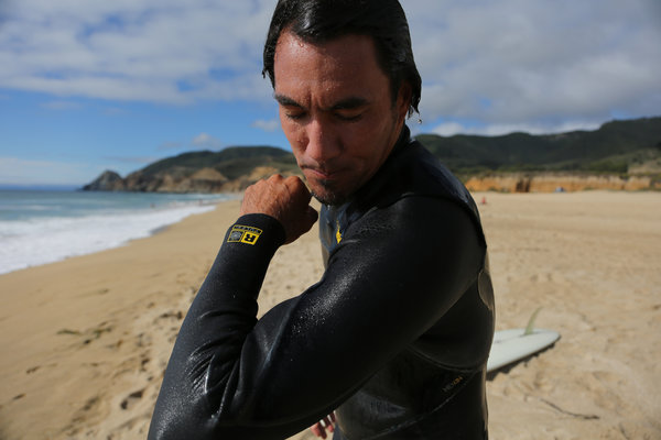 Jon Kitamura in a Patagonia wet suit at Montara State Beach, California. Credit Jim Wilson/The New York Times