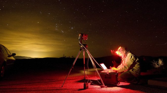 Dan Duriscoe works at a special computer-controlled camera used to photograph the night sky at Dantes View in Death Valley National Park in California. John Locher/AP