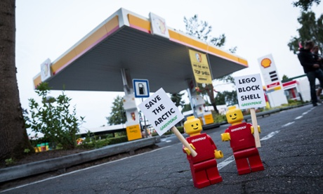 Mini activist figures at a Shell gas station in Legoland in Billund, Denmark, part of a global campaign targeting Lego and highlighting Shell's plans for Arctic oil exploration. Photograph: Uffe Weng/Greenpeace