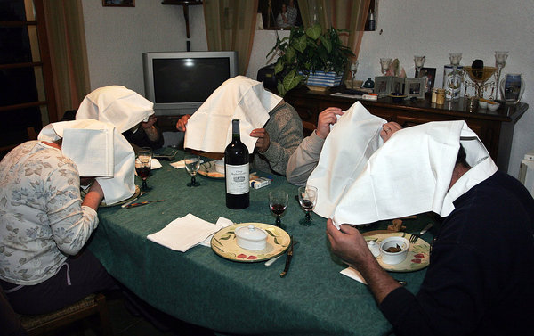 Guests eating ortolan at a private dinner party in southwestern France after the bird was banned from restaurant menus. Credit Richard Cottenier/MAXPPP