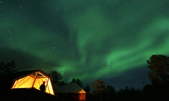 Northern lights over a camp north of the Arctic Circle, October 2014 (Yannis Behrakis/Reuters)