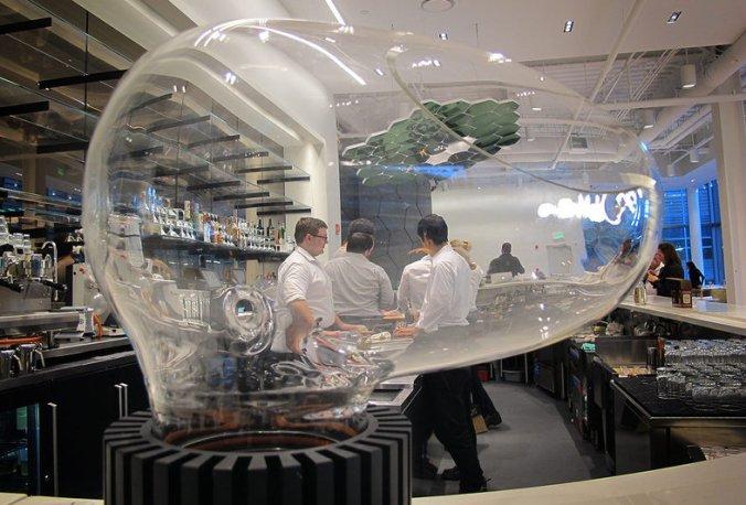 Le Laboratoire Cambridge features a restaurant, the Cafe ArtScience. The restaurant's bar features a glass-globed drink vaporizer called Le Whaf. Andrea Shea/WBUR