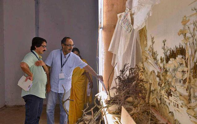 V. Venu, director-general of the National Museum in Delhi (in blue), viewing Xu Bing's work at Aspinwall House  in Kochi on Sunday.