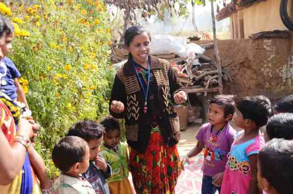 Nursery worker Shivkumari Pate leads children in a learning song. Pate works with the nonprofit Jan Swasthya Sahyog, which developed the first network of community nurseries. Ankita Rao for NPR