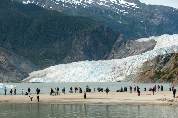 Tourists visit the the Mendenhall Glacier, in Alaska. Geologists are considering whether humans' impact on the planet has been significant enough to merit the naming of a new epoch. CREDIT PHOTOGRAPH BY MATTHEW RYAN WILLIAMS/THE NEW YORK TIMES/REDUX