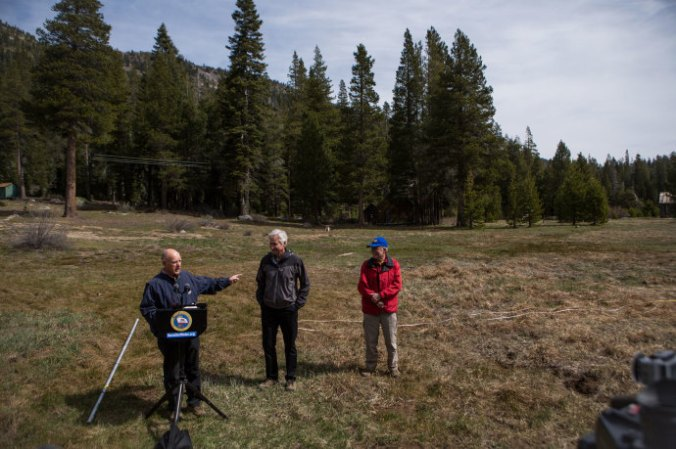 California Governor Jerry Brown, left, discusses snowpack at Phillips Station, which this year is bare in April for the first time ever. PHOTOGRAPH BY MAX WHITTAKER/GETTY