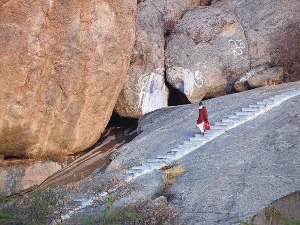 An elderly priest descending to Perwa village from a temple devoted to Lord Shiva on Perwa Hill where he lives, one of the many holy slopes in the region that is also home to leopards. Credit Richard Mosse