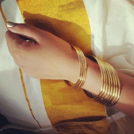 White and gold dominate attire during Onam celebrations.