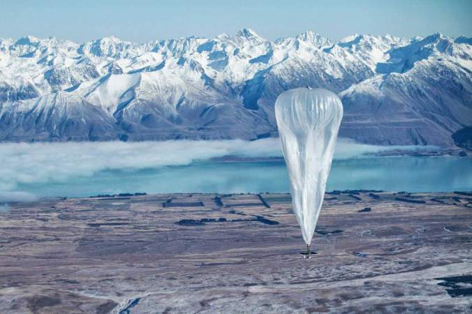 In this June 10, 2013 photo released by Jon Shenk, a Google balloon sails through the air with the Southern Alps mountains in the background, in Tekapo, New Zealand (AP Photo/Jon Shenk)