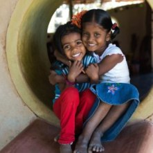 Two kindergarten kids in the playground just outside the classroom. PHOTO: Vikalp Sangam