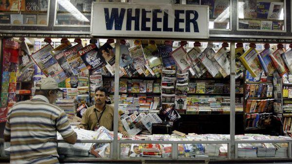 A vendor attends a customer at a railway platform at Mumbai, India. PHOTO: Reuters