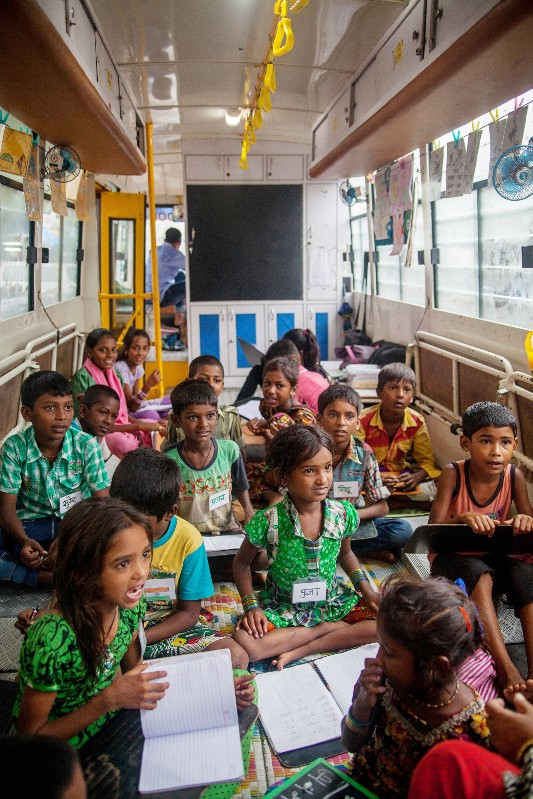 The buses can only hold 20 students, without much space to wiggle around or store books. But they have unique benefits — like their ability to reach many of Mumbai's poorest migrants who live on illegal plots of land where schools can't be built. PHOTO: Karen Dias