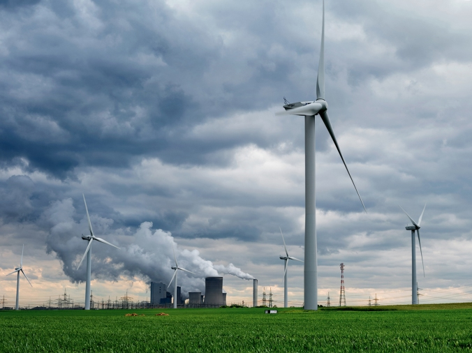 Wind turbines surround a coal-fired power plant near Garzweiler in western Germany. Renewables now generate 27 percent of the country's electricity, up from 9 percent a decade ago. PHOTO: Nat Geo