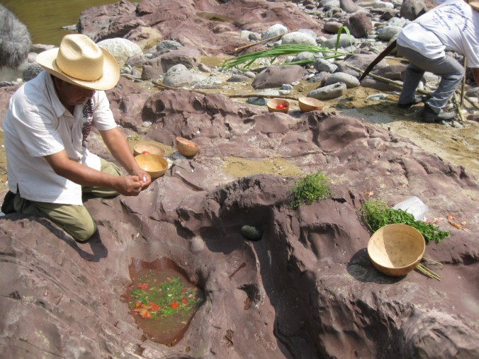 Chinatec elders prepare stone soup the traditional way, by the Papaloapan River. PHOTO: SARAH BOREALIS
