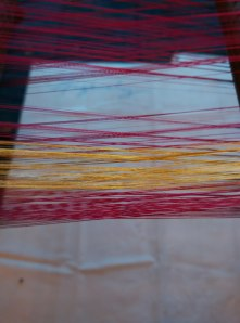 Golden thread to be woven into patterns in between the sari