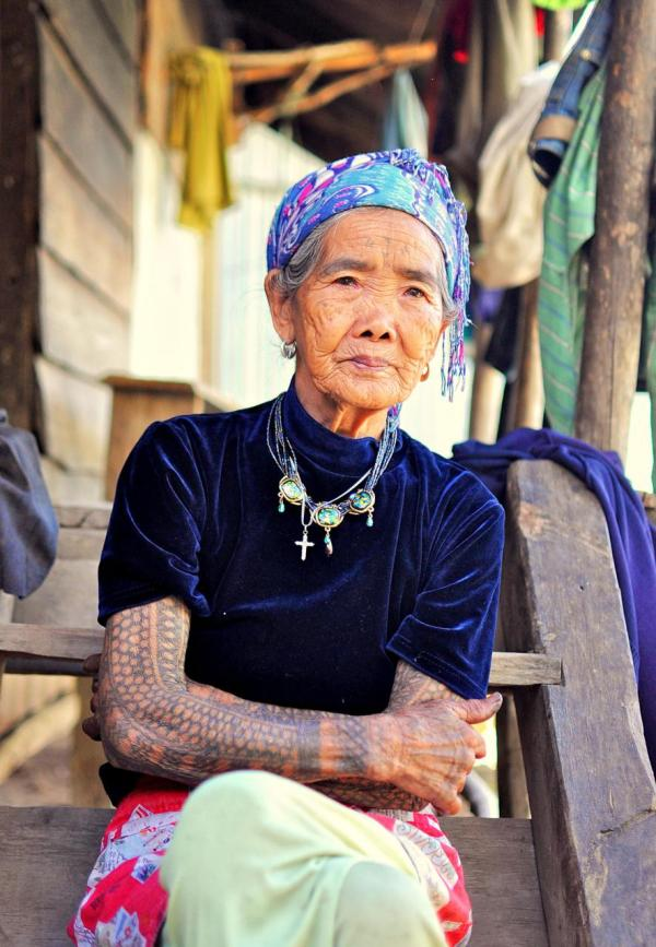 A dying Filipino tattoo tradition is being revived – and forever changed – by the international travellers seeking to get inked by its last tribal artist, 97-year old Apo Whang-Od. (Credit: Travel Trilogy)