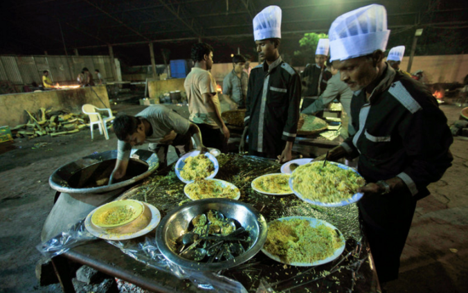 Indian weddings (and other big parties) serve a lot of food — and have a lot of leftovers. Now there's a plan in Mumbai to share the surplus with those who are hungry. Mahesh Kumar A./AP