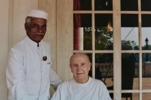 "An employee of the Madras Club, with ""master"" John Davis, who has been going to the club since he was 20 years old."
