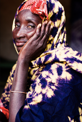 Aminata Konté, Kéréouane Village. Married at age 17Ami's role with the Grandmother Project is to protect the young girls of her village. She sensitizes them to the dangers of early marriage and urges them to speak out if they don't feel comfortable with the time that their parents want them to get married. She also explains and educates mothers on the dangers of female genital mutilation – a practice that has been a cultural tradition for centuries in Senegal. Once they identify that a young girl has a problem, the grandmothers of the community come together to discuss what to do as a group, and then confront the parents together. The parents rarely argue since elders are the most respected members of their community.Photograph by Tara Rice.